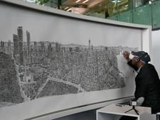 Autistische artiest kan stad na één blik perfect natekenen