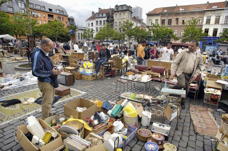 De wereldbekende rommelmarkt op het Vossenplein. Die wordt bedreigd door plannen voor een ondergrondse parking.