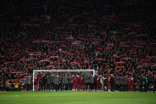 LIVERPOOL, ENGLAND - MAY 07:  Liverpool players celebrate with fans after the UEFA Champions League Semi Final second leg match between Liverpool and Barcelona at Anfield on May 07, 2019 in Liverpool, England. (Photo by Shaun Botterill/Getty Images)