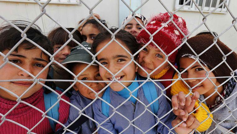 Syrische vluchtelingen in een vluchtelingenkamp in Mafraq, Jordanië. Beeld REUTERS