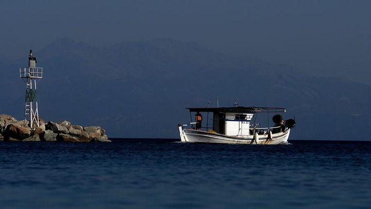 De haven van Agii Apostoli, op een foto van begin augustus. Beeld afp