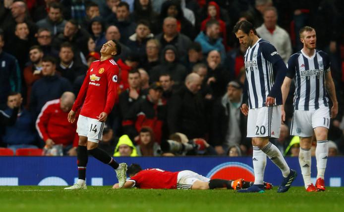 Teleurstelling bij de spelers van United in het rood