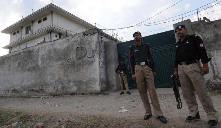 Het huis waar Bin Laden zich jarenlang verborgen hield in Abbottabad. Het werd in 2012 gesloopt door de Pakistaanse regering. Via een van de koeriers van de Al Qaida-leider wist de CIA uiteindelijk achter zijn schuilplaats te komen. Beeld AFP