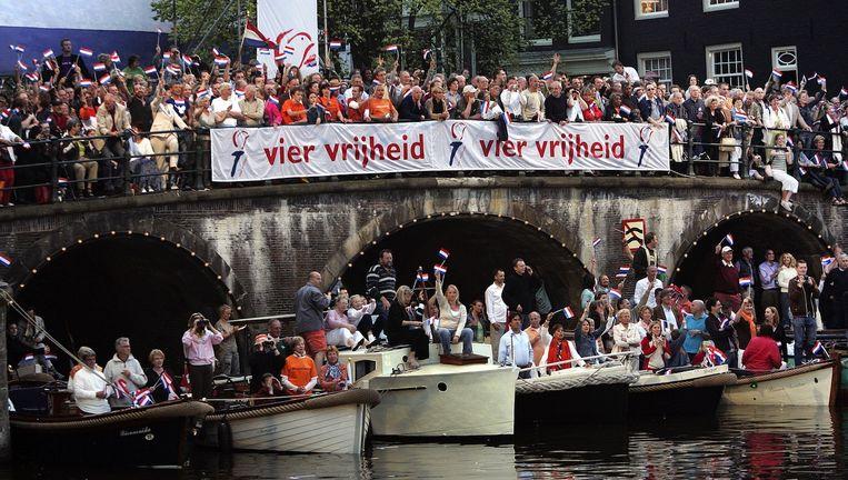 Veel werknemers zouden graag vrij willen omdat naar een Bevrijdingsfestival of -concert te gaan. Beeld anp