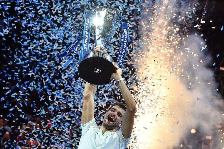 Grigor Dimitrov viert het winnen van de ATP Finals. Beeld AFP