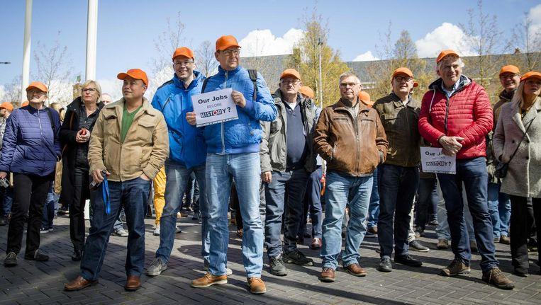 Medewerkers van AkzoNobel voor aanvang van de jaarlijkse Algemene Vergadering van Aandeelhouders (AvA) in de RAI Amsterdam vorige maand. Beeld anp