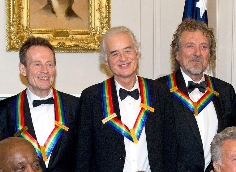 Led Zeppelin zondag op het Witte Huis, vanaf links: John Paul Jones, Jimmy Page en Robert Plant. Beeld getty