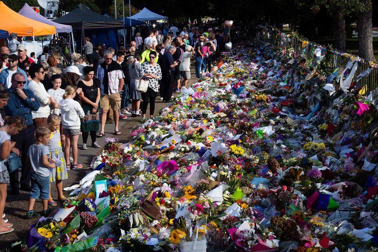 Een bloemenzee voor de slachtoffers in Christchurch. Beeld AFP/ Marty Melville