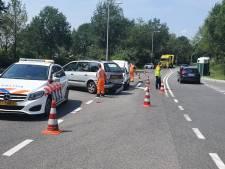 Paard met de schrik vrij bij aanrijding in Vaassen: verkeershinder voor A50