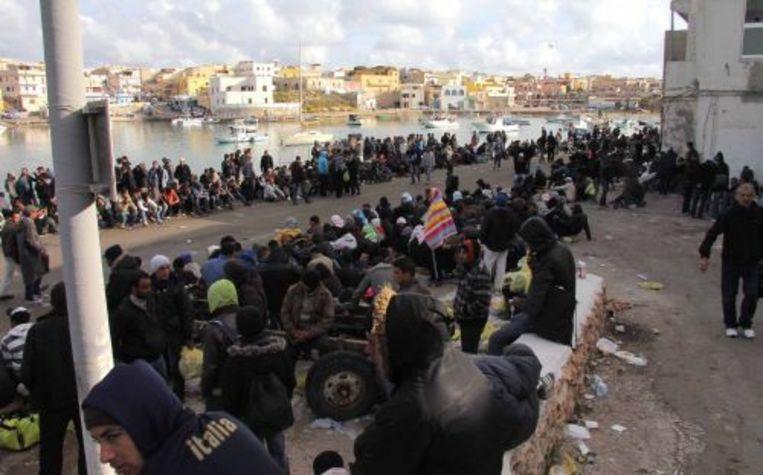 Vluchtelingen op Lampedusa. EPA Beeld