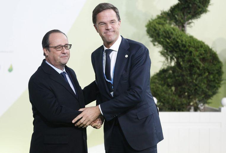 Mark Rutte en Francois Hollande bij de opening van de klimaattop in Parijs. Beeld anp