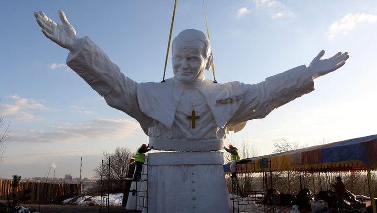 Een beeld van Paus Johannes Paulus in Polen. Beeld EPA