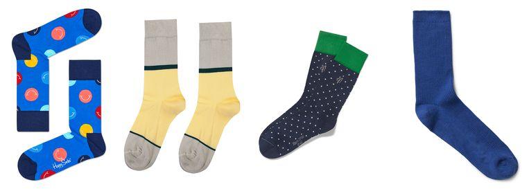 Van links naar rechts: blauw met smiley's van Happy Socks, €9,95 - grijs-lichtgeel van Heroes on Socks, €9,99 - donkerblauwe polkadot met groene rand van Marc O'Polo, €9,95 - blauwe ribsokken van Weekday, €7. Beeld