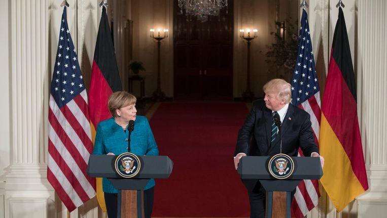 Merkel en Trump tijdens een gezamenlijke persconferentie op vrijdag Beeld epa