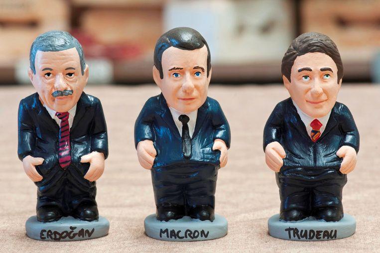 De Turkse en Franse president en de premier van Canada.