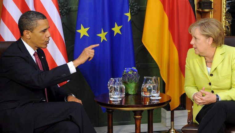 President Barack Obama en bondskanselier Angela Merkel. Foto EPA/Ralf Hirschberger Beeld