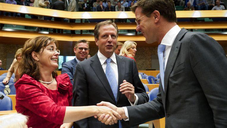 Jolande Sap van GroenLinks (l), Alexander Pechtold van D66 (m) en premier Rutte (VVD, r). © ANP Beeld