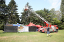 Twee nieuwe partytenten van de Stroppenconcerten werden meters hoog in de bomen geblazen tijdens de storm.