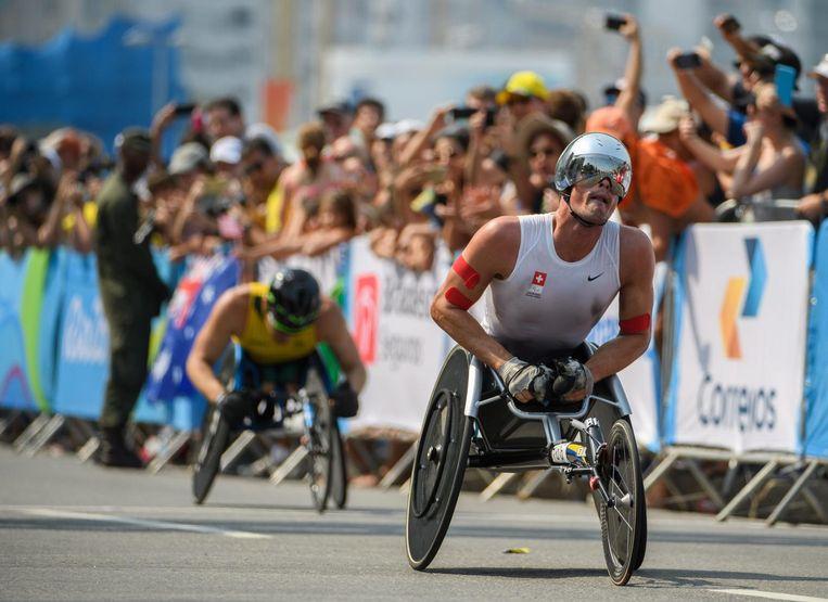 Marcel Hug uit Zwitserland in de T54 marathon. Beeld anp