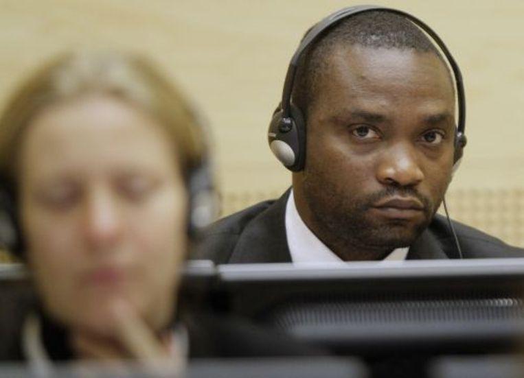 Germain Katanga uit de Democratische Republiek Congo hoort zijn tenlastelegging aan in het Internationaal Strafhof in Den Haag. ANP Beeld