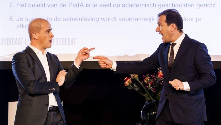 Kandidaat-lijsttrekkers van de PvdA Diederik Samsom en Lodewijk Asscher debatteren over de koers van de partij. Beeld anp