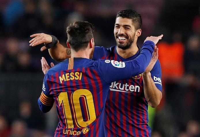 Lionel Messi met zijn aanvalsmaatje Luis Suárez.