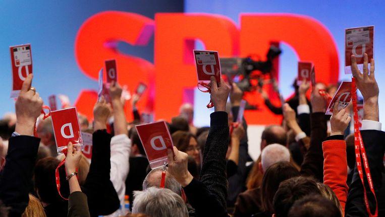 SPD-afgevaardigden stemmen voor coalitiedeelname met CDU/CSU Beeld ap