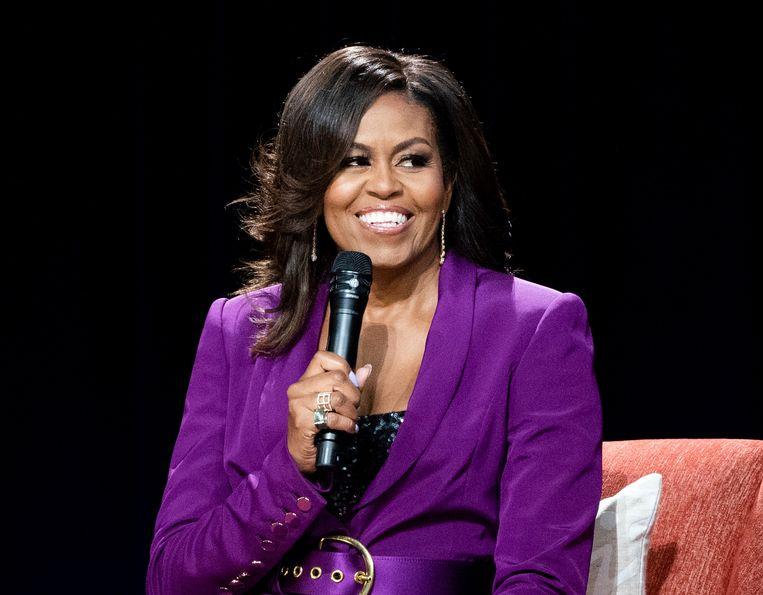 Michelle Obama tijdens een optreden over haar boek 'Becoming'.  Beeld Paul R. Giunta/Invision/AP