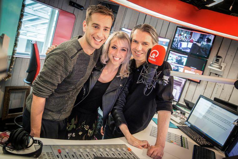 Het Qmusic-ochtendtrio Sam De Bruyn, Heidi Van Thielen en Wim Oosterlinck, die vanmorgen voor het eerst de verkeersinformatie lazen met Waze.