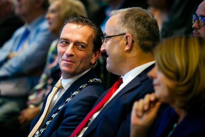 """Michel Bezuijen naast burgemeester Ahmed Aboutaleb. ,,Bezuijen heeft een enorme drive en passie."""""""
