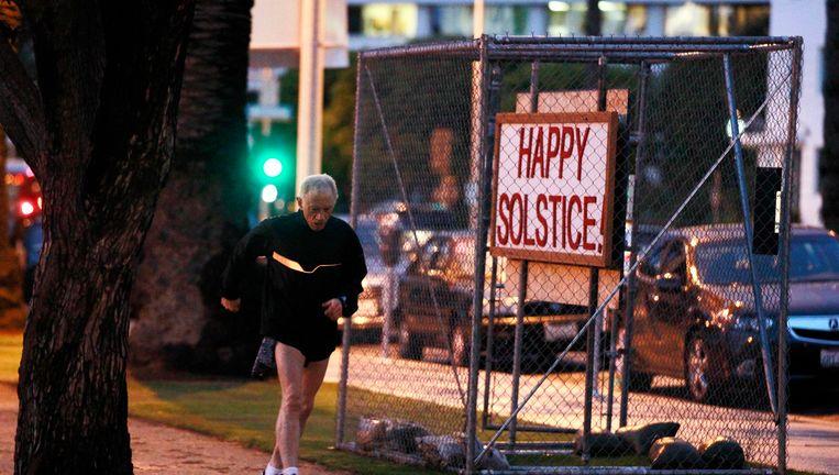 Een bord met 'Happy Solstice!' ('Vrolijke zonnewende!'), onderdeel van de atheïstische expositie. Beeld REUTERS