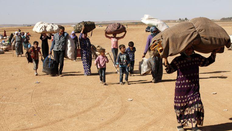 'In Urfa wonen 500 duizend Syrische vluchtelingen. Met stadslandbouw op de watermatten kunnen ze bijdragen aan hun eigen voedselvoorziening en hebben ze vooral wat zinvols om handen.' Beeld getty
