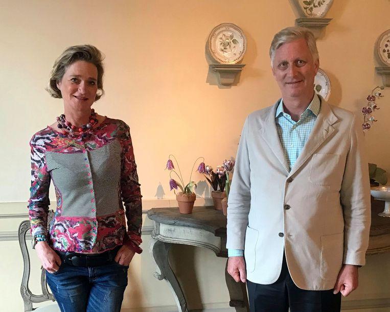 Koning Filip en prinses Delphine in het Kasteel van Laken. Beeld AFP