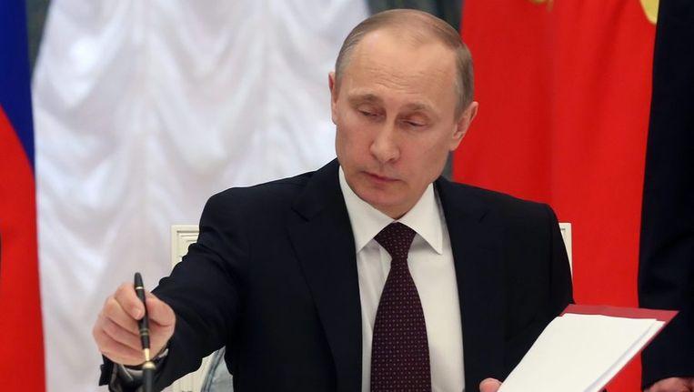 Poetin ondertekent de wet die de annexatie van de Krim een feit maakt Beeld epa