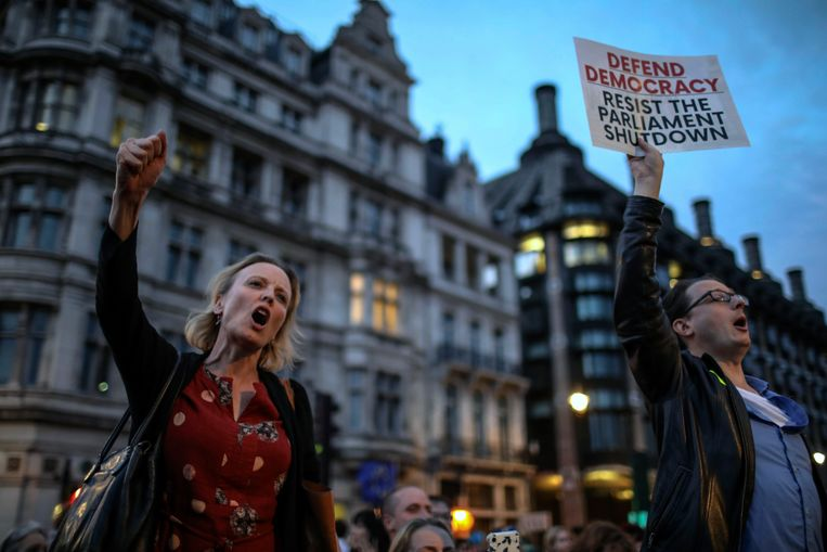Anti-Brexit supporters tijdens het protest. Beeld AP