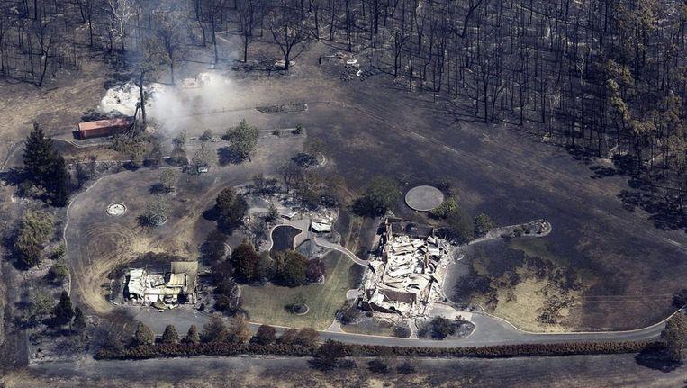 Uitgebrande huizen ten westen van Sydney. Beeld epa