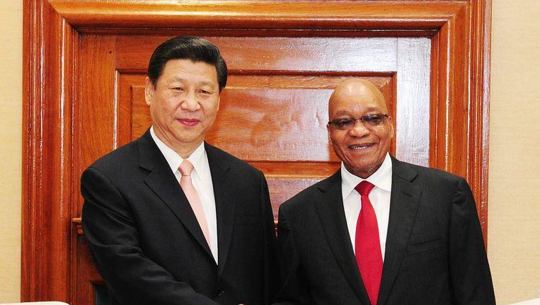 De Chinese president Xi Jinping en zijn Zuid-Afrikaanse collega Jacob Zuma zijn twee van de Brics-leiders die de komende dagen in Brazilië overleggen Beeld EPA