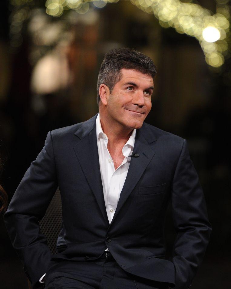 Simon Cowell verklaarde dat hij zelf was geobsedeerd door Dannii's borsten.