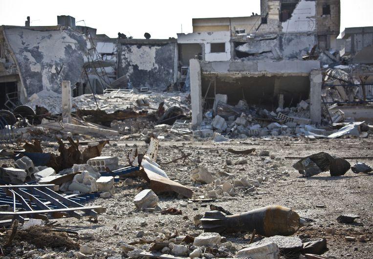 Een kapotgeschoten wijk in de Syrische stad Kobani. Beeld ap