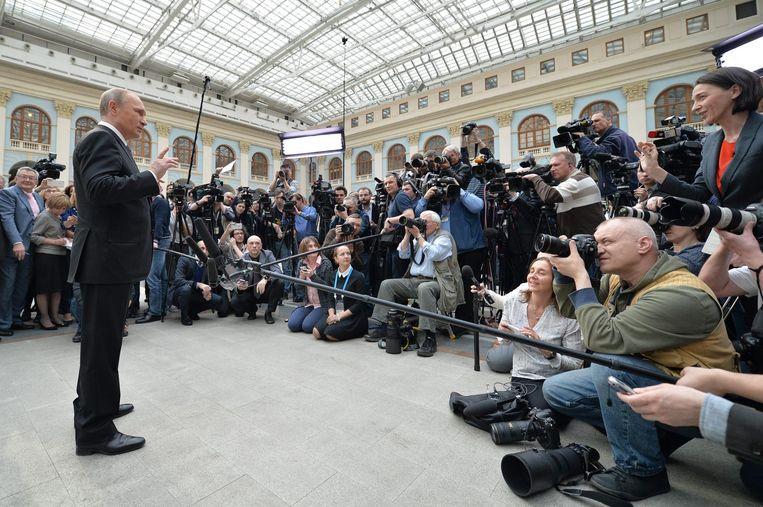 Poetin tijdens zijn jaarlijkse vraag-en-antwoord, uitgezonden via Sputnik. Beeld EPA