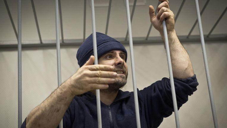 De Britste Greenpeace-activist Ian Rogers tijdens zijn borgtocht-hoorzitting in Moermansk. Foto aan Reuters verspreid door Greenpeace. Beeld reuters