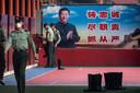 Beveiligers in Peking bereiden zich voor op het begin van het Nationale Volkscongres, dat morgen begint.