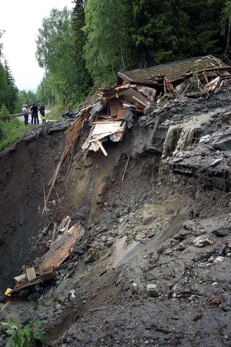 Huizen zijn verwoest door aardverschuivingen en modderstromen. Beeld afp
