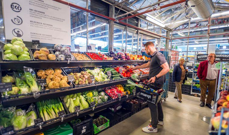 Interieur van Marqt. De winkelketen verkoopt duurzame, verse, biologische en lokale producten. Beeld ANP XTRA