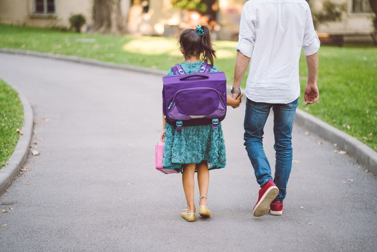 Cute girl with her father on their way to school