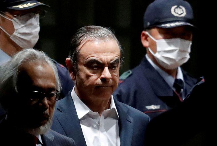 Carlos Ghosn in april 2019, bij het verlaten van een detentiecentrum in Tokio. Beeld Reuters