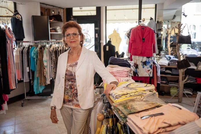 Mitzi Ottevanger te midden van haar 'fashion'. ,,Ik heb me altijd op de laatste mode gericht.''