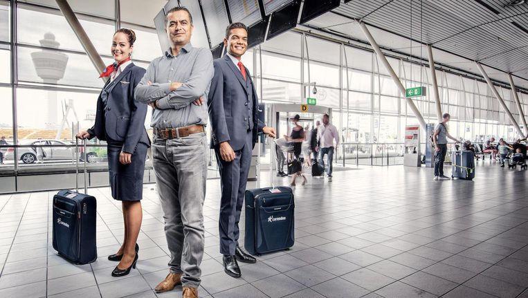 Volgens Corendon-oprichter Atilay Uslu, in het midden, is de toerisme-overlast te wijten aan de Amsterdammers zelf. Beeld Martin Dijkstra