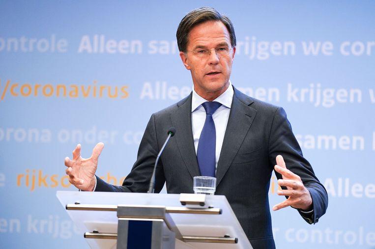 Premier Mark Rutte geeft toelichting op de aanscherping van de coronamaatregelen in Nederland. Beeld ANP