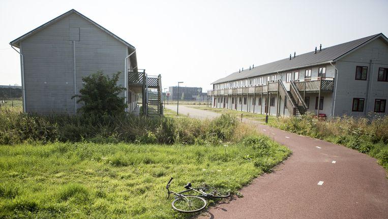 Een gebouwencomplex buiten Nijmegen, waar voornamelijk Eritrese vluchtelingen zijn ondergebracht. Beeld Julius Schrank